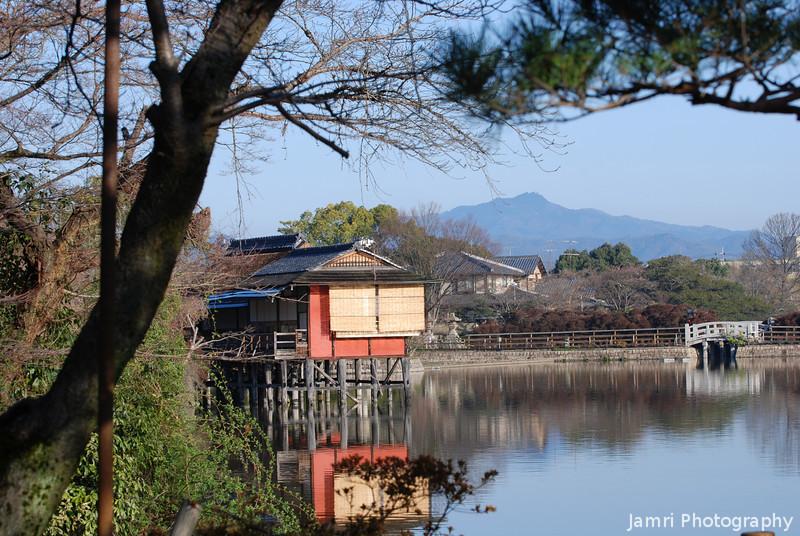 On a clear a crisp morning.<br /> The view across the lake near Nagaoka Tenmangu Shrine towards Mt. Atago.