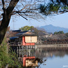On a clear a crisp morning.<br /> The view across the lake near Nagaoka Tenmangu Shrine towards Mt. Atago.