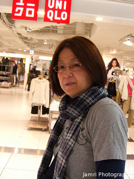 "Ritsuko outside the new Uniqlo.<br /> There's a new huge Uniqlo in Kyoto, which just happens to be in the new Yodobashi Camera building, so any time I want to check out the latest cameras, I just say to Ritsuko ""let's go to the big Uniqlo"" and she says ""YES"". Pretty smart thinking Yodobashi Camera!"