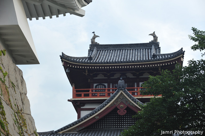The smaller tower framed by the larger.<br /> At Fushimi-Momoyama-jo.
