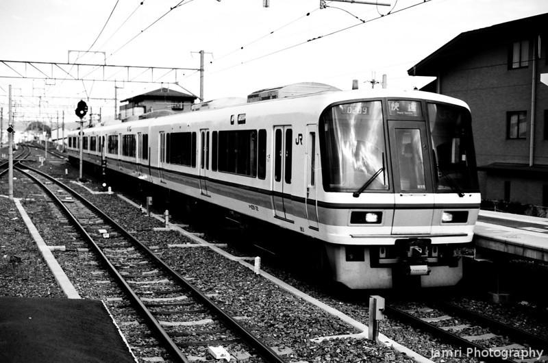 JR Train Approaching Saga Arashiyama Station.<br /> Note Film Shot: Nikon F80 + 50f/1.8 + Orange Filter + Fujifilm Neopan Acros