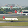 Taking off and Landing.<br /> A JAL (Japan Air Commuter) Saab 340B taking off in the foreground and a JAL (JAL Express) 737-800 in the background.