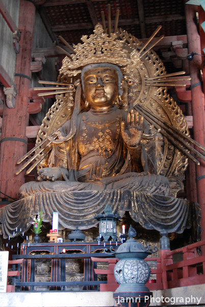 One of the Big Buddha's companions.<br /> This one of the two smaller Buddhas that sit on each side of the Big Buddha in Todai-ji (Todai Temple) in Nara.