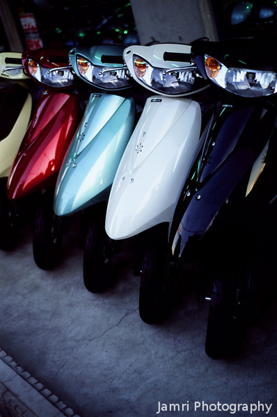 Scooters<br /> A line up at a shop selling new scooters.<br /> Note Film Shot: Nikon F80 + Nikkor 50 f/1.8 + Fujichrome Velvia 50