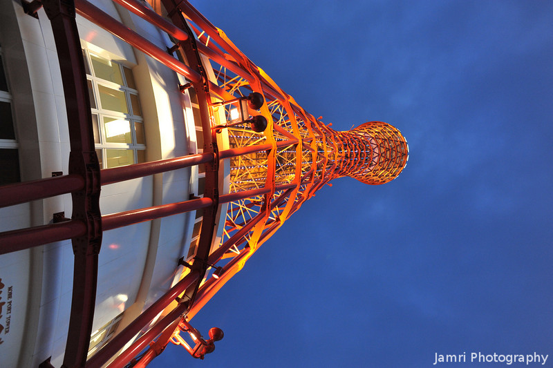 Looking up at the lit up Kobe Port Tower.