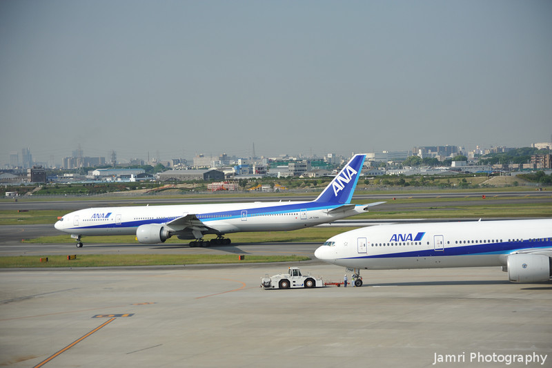 Two ANA Boeing 777-300s.<br /> At Osaka Itami Airport.