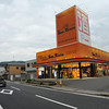 "Sun Feiste.<br /> An alcohol shop. That big kanji character above the ""P->"" sign is the kanji for alcohol. Actually in Japan anywhere can sell alcohol including supermarkets and convenience stores, but these speciality stores have more range."