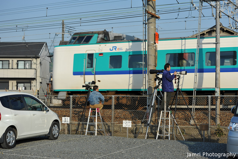 Catching the Action.<br /> Railfans get to work capturing a shot of a Limited Express.