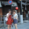 Chimping Pretty.<br /> A couple of young ladies chimp on the streets of Gion.