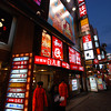 Searching for a place to eat.<br /> Too many choices along Dotonburi Street!