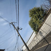 Power lines and a wall.<br /> Testing a crop lens (Sigma EX DC 10-20f/4-5.6) on a Full Frame (Nikon D700). f/4.8 at 14mm.