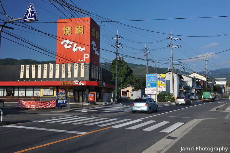 Looking Up Suntory Dori towards Nishiyama.<br /> Den Yakiniku restaurant on the left.