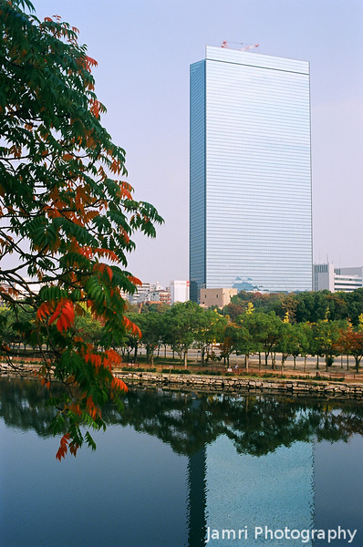 Still Waters, Autumn Leaves, and a Shiny Building.<br /> A building in Osaka Business Park, from the Osaka Castle grounds.<br /> Note Film Shot: Nikon F80 + 35f/2 Lens + Kodak Ektar 100