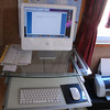 Ritsuko's iMac with new wireless keyboard and mouse.<br /> Now that the keyboard and mouse are wireless the only wires coming out of the computer are power cable and printer cable. Compared to the PCs at my previous job in Australia that's not very much. On those we had 1. wire for keyboard, 1. wire for the mouse, 2. wires for the monitor (power and video), 2. Wires for the Speakers (power and sound) 1. Power cable for the CPU. 1 Network Cable. Mac are just so much cleaner!