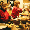 The Mochi Sellers.<br /> Mochi are rice cake sweets, that are popular in Japan. This place was doing good business with the crowds in Arashiyama for Hanatouro.<br /> Note Film Shot: Nikon F80 + Nikkor 35 f/2 + Fujicolor PR400
