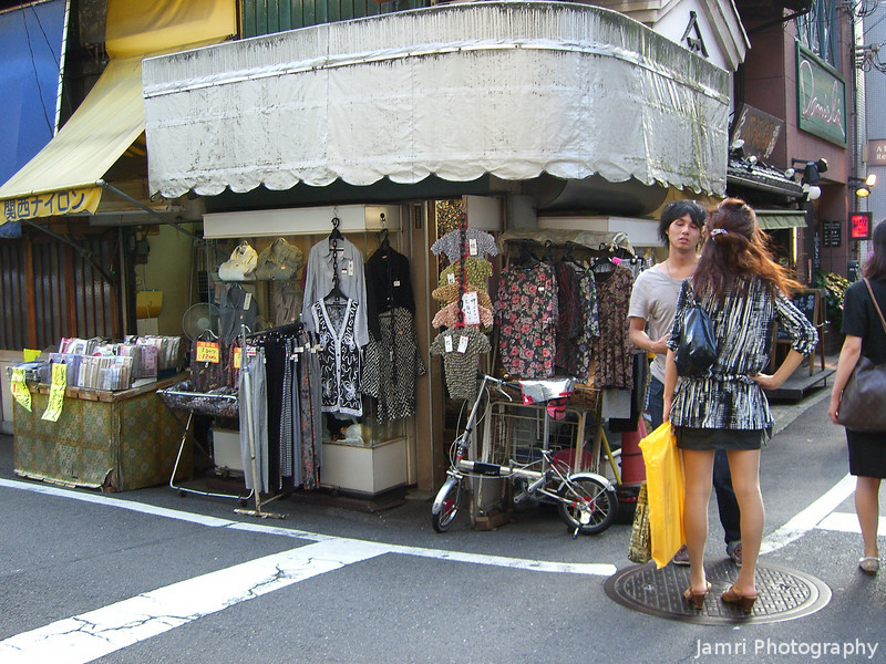 Discussion on a street corner.<br /> In the Streets of Kyoto.