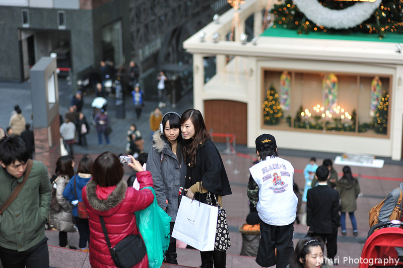Capturing Ritz' Capture.<br /> Ritsuko takes a photo for two pretty tourists from Hong Kong near the big tree in Kyoto Station.