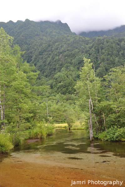 Red stream and mountains.<br /> At Kamikochi National Park, Nagano Prefecture, Japan.