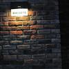Kakimoto (a family name).<br /> Interesting brick veneer on a house in Nagaokakyo.