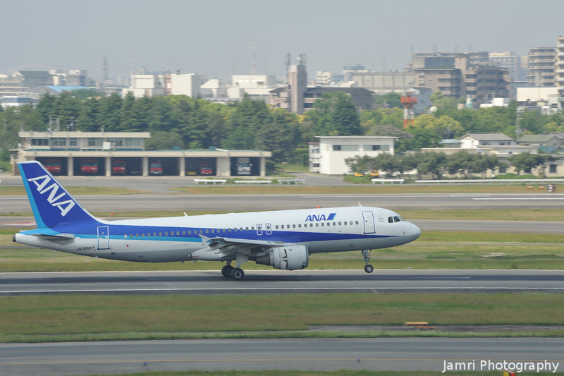 Slowing down.<br /> An ANA A320 just after touching down at Itami.