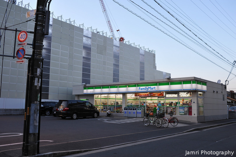 Towards Family Mart.<br /> With the construction site of a new aged care facility next to it.