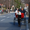 Going for a ride.<br /> A couple take a ride on a rickshaw in Arashiyama, Kyoto.