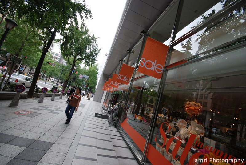 """Sale Time.<br /> In the streets of Shinsaibashi banners announce that it's """"Sale Time""""."""
