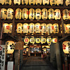 At the Entrance to the Shrine.<br /> In the Shinkyogoku Arcarde, Kyoto there is a Shrine in the middle of the busy shopping area. It has probably been there for years and the shops were just added around it.