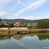 Reflections<br /> This is a view across the lake near Nagaoka Tenmangu Shrine in Nagaokakyo. The houses behind are in one of this city's more expensive neighbourhoods.