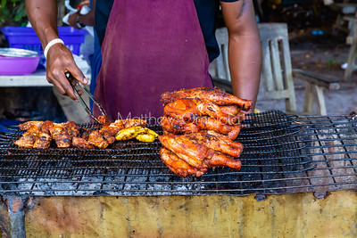 Street foods Lagos Nigeria, Grilled chicken on charcoal fired grill in Lekki Lagos Nigeria