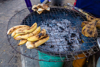 Bole or roasted plantain is a staple of Nigerians and a common street food in Lagos. Usually done on charcoal fired grill. Isu sisun or roasted yam is at the back on the left and sweet potato on the right.