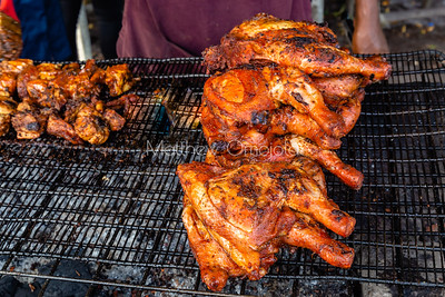 Street foods Lagos Nigeria, Grilled chicken on charcoal fired grill in Lekki Lagos, Nigeria.
