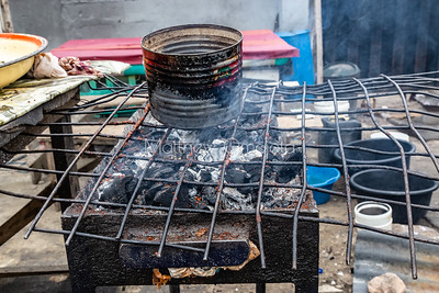 Street foods, Close up of charcoal fired grill for suya, a form of meat or beef kebabs by the roadside Victoria Island Lagos Nigeria.