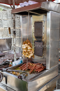 Shawarma stand (chiken) on Lagos street. Sausages on the tray