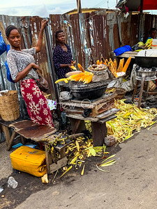 Street foods Lagos Nigeria, Editorial photo of roasted corn, Agbado, on charcoal fired grill in Lagos. The surroundings may not be as clean and healthy looking as one would want. It is affordable by artisans and regular folks!