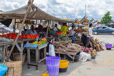 Editorial photo of makeshift shed for street foods in Lekki, Lagos. Tomatoes, cucumber, yam, onion, potatoes, carrots, etc are on sale.