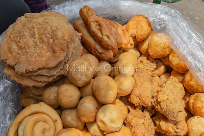 Street foods Lagos Nigeria, Close up Pastries on Lagos street; fish pie, egg rolls, puff puff, donuts or doughnuts, meat pie, sausage roll.