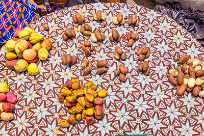 Street foods Lagos Nigeria, Kola nuts and bitter kola arranged on a tray on Lagos street.