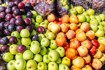 An array of fruits; apples, grapes, plums,  etc on lagos street.