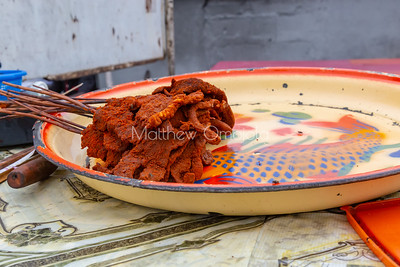 Street foods, Suya or beef kebab coated with local spices-suya spice roadside Victoria Island Lagos Nigeria