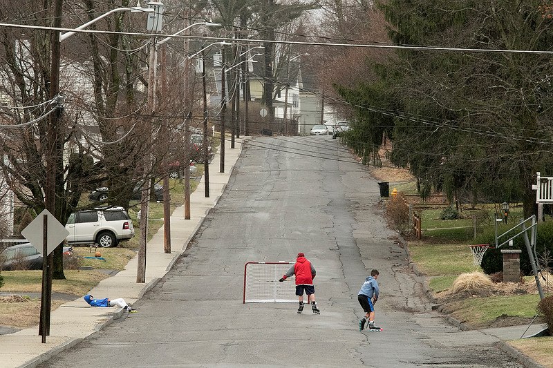 The rain did not bother these kids in Leominster on Monday afternoon. They still got out of the house to play some street hockey. SENTINEL & ENTERPRISE/JOHN LOVE