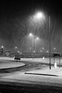 Snow after dark in Solihull, England