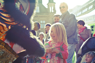 Look Mum - Chinese Lion comes face to face with young girl during Dance @ Birmingham Food Festival, 15th October 2011