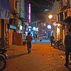 """Alley in New Delhi at Khan Market.   Heading down to eat at  our favorite restaurant, """"The Big Chill""""."""