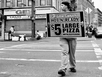 Signboard carrier, Harlem