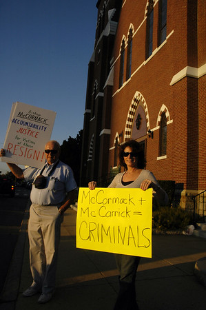Protesters calling for the resignation of Bishop McCormick, outside the Catholic church.