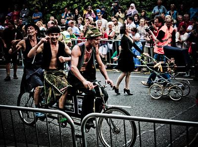 Three men on a bike... and a pram