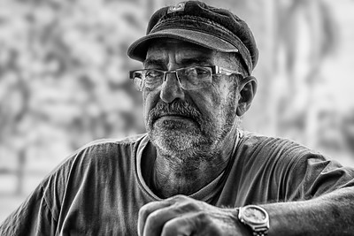 Cuba, Mantanzas.  Portrait of a local farmer wearing cap and glasses