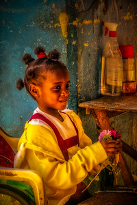 Cuba, Havana.  Young girl with flowers at a farmer's market in Old Havana.