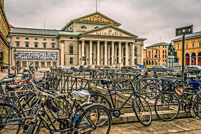 Germany, Munich, National Theater and the Bavarian State Opera with bicycles in the foreground